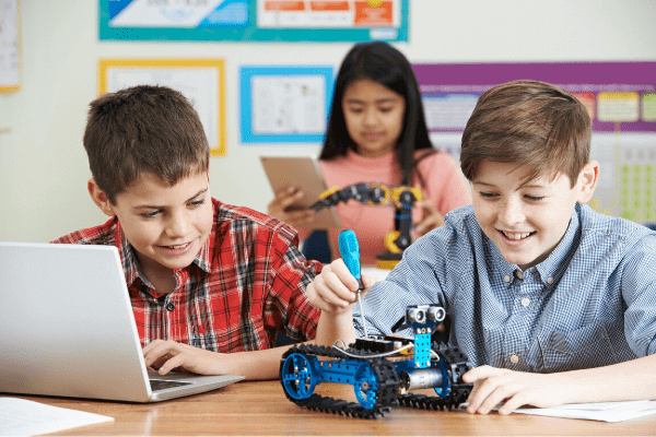 Kids are  playing with Makeblock Coding Robots